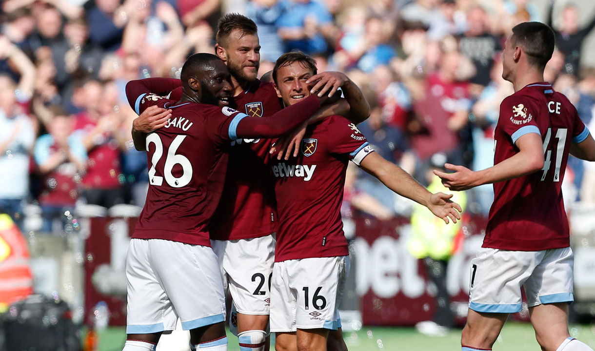 West Ham's players celebrate scoring against Manchester United at London Stadium