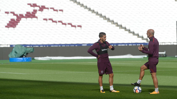 Pablo Zabaleta and Manuel Lanzini chat during a training session at London Stadium