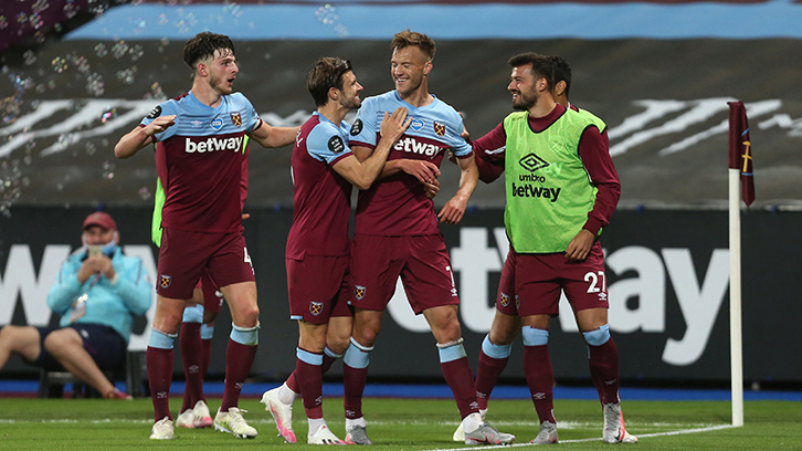 Cresswell celebrates with Yarmolenko and team-mates