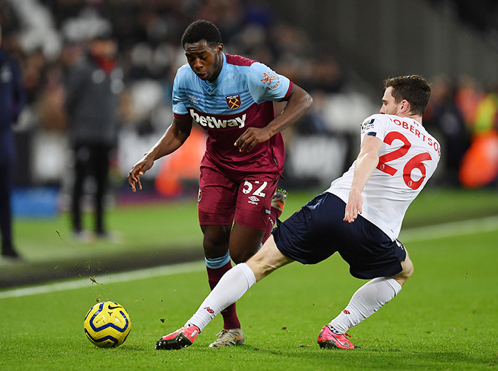 West Ham United's Jeremy Ngakia takes on Liverpool's Andy Robertson