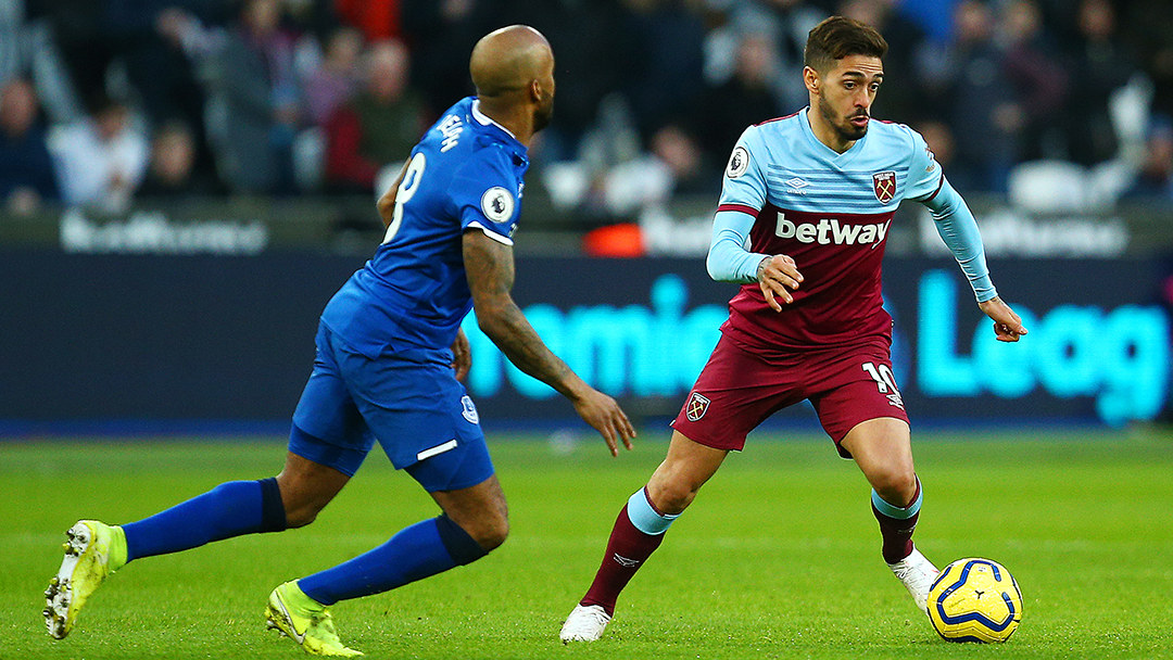 Manuel Lanzini vies for the ball for West Ham United