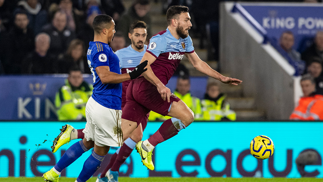 Robert Snodgrass vies for the ball against Leicester City